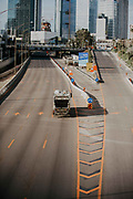 The outbreak of COVID-19 has forced governments around the world to impose a civil quarantine. The outcome of this are empty streets and public places. Photographed on Ayalon Highway in Tel Aviv, Israel on April 8th 2020