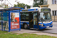 Bus stop in Krakow with a poster for Lech Kaczynski on it
