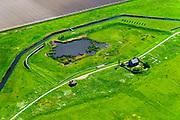 Nederland, Flevoland, Noordoostpolder, 07-05-2018; Schokland, noordelijk punt van het voormalig eiland in de Zuiderzee, met restanten van de voormalige haven Emmeloord, vuurtoren, lichtwachterswoning. Onderdeel van de UNESCO Werelderfgoedlijst. Het verlagen van de grondwaterspiegel in de Noordoostpolder leidt tot inklinking waardoor het eiland steeds lager komt te liggen. Om verder wegzinken te voorkomen een hydrologische zone aangelegd. Village and former island. Part of the UNESCO World Heritage List. The center is the Reformed Church. Lowering the groundwater level in the Noordoostpolder leads to subsidence and causes the island the sink away. In order to prevent further decline a hydrological zone has been created.<br /> luchtfoto (toeslag op standard tarieven);<br /> aerial photo (additional fee required);<br /> copyright foto/photo Siebe Swart