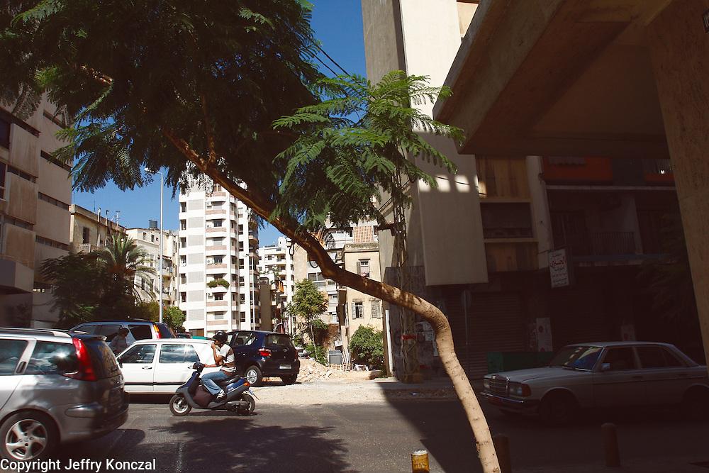 A man drives a mopad along a street in Beirut, Lebanon.