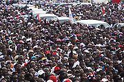 Supporters surround a row of cars during a New Patriotic Party (NPP) campaign rally in Ghana's capital Accra on Friday December 5, 2008. Thousands of Ghanaians gathered in final rallies as they prepared to head to the polls on Sunday December 7 to elect a new government.