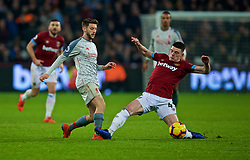 LONDON, ENGLAND - Monday, February 4, 2019: Liverpool's Adam Lallana (L) and West Ham United's Declan Rice during the FA Premier League match between West Ham United FC and Liverpool FC at the London Stadium. (Pic by David Rawcliffe/Propaganda)