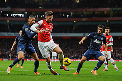 Arsenal Forward Olivier Giroud (FRA) is challenged by Man Utd Defender Chris Smalling (ENG) - Photo mandatory by-line: Rogan Thomson/JMP - 07966 386802 - 12/02/14 - SPORT - FOOTBALL - Emirates Stadium, London - Arsenal v Manchester United - Barclays Premier League.
