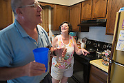 Ralph and Rosemarie Paladino share a laugh at their home in Utica, NY on September 3, 2015. The Paladinos live primarily on Ralph's police officer's pension and social security, and have home equity loan with an interest rate linked to the prime lending rate. A Fed rate increase would force their already tight budget even further. Photographer: Mike Bradley/Bloomberg