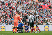 Nicky Wroe (c) (Halifax) receives treatment in injury time and is surrounded by Grimsby players as they think he is trying to run the clock down during the FA Trophy match between Grimsby Town FC and Halifax Town at Wembley Stadium, London, England on 22 May 2016. Photo by Mark P Doherty.