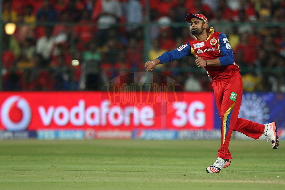 Virat Kohli captain of the Royal Challengers Bangalore throws the ball during match 20 of the Pepsi IPL 2015 (Indian Premier League) between The Royal Challengers Bangalore and The Chennai Superkings held at the M. Chinnaswamy Stadium in Bengaluru, India on the 22nd April 2015.<br /> <br /> Photo by:  Deepak Malik / SPORTZPICS / IPL