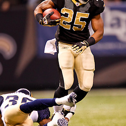 December 12, 2010; New Orleans, LA, USA; New Orleans Saints running back Reggie Bush (25) is tripped up by St. Louis Rams cornerback Quincy Butler (36) during the first half at the Louisiana Superdome. Mandatory Credit: Derick E. Hingle-US PRESSWIRE