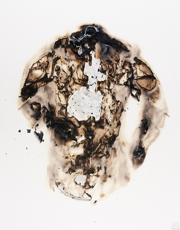 A shirt that is part of a photo series of burnt objects and it's ashes