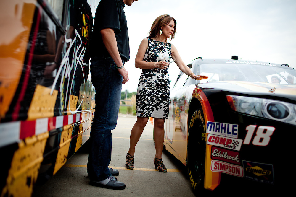 Republican presidential candidate, Rep. Michele Bachmann checks out the Joe Gibbs Racing Pizza Ranch car at a campaign stop held at a Pizza Ranch in Newton, Iowa, August 5, 2011.