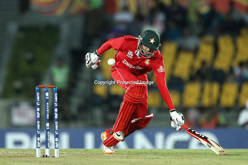 Graeme Cremer makes it back in time during the ICC World Twenty20 Pool C match between South Africa and Zimbabwe held at the MAHINDA RAJAPAKSA INTERNATIONAL CRICKET STADIUM in Hambantota, Sri Lanka on the 20th September 2012<br /> <br /> Photo by Ron Gaunt/SPORTZPICS