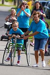 © Licensed to London News Pictures. 01/08/2020. Sheffield, UK. Tobias Weller aged 9,Sheffield, completes the final 1.2km leg of his marathon in Sheffield, South Yorkshire. Nine-year-old Tobias Weller, from Sheffield, who has cerebral palsy and autism, has raised over £100,000 for Children Hospital Charity and Paces by walking a 26.2-mile marathon during the lockdown. Tobias Weller has been inspired by WWII veteran Captain Sir Thomas Moore to take his fundraising one step ahead.<br />  Photo credit: Ioannis Alexopoulos/LNP