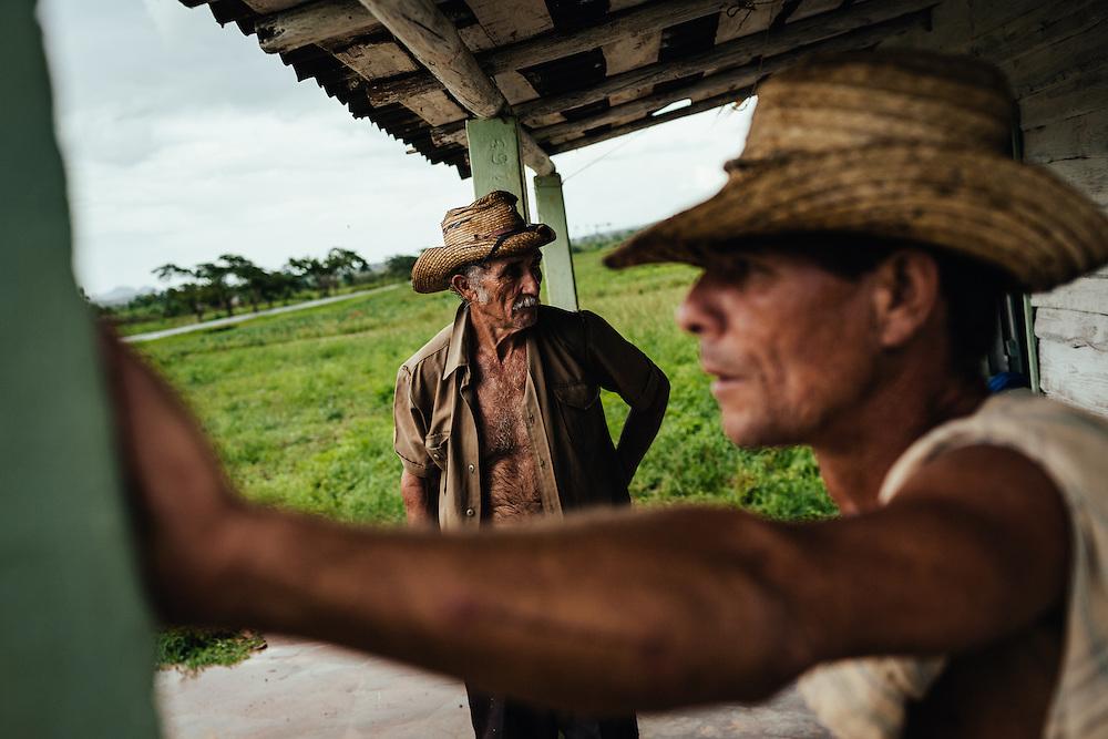 Farmers in Vinales Cuba wait for a rainstorm to pass. Vinales, Cuba, 2009