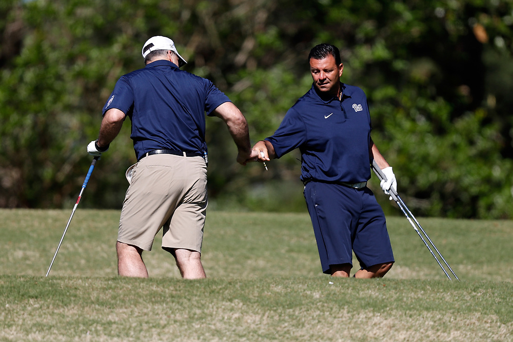 Pat Narduzzi celebrates with John Congemi during the Chick-fil-A Peach Bowl Challenge at the Oconee Golf Course at Reynolds Plantation, Sunday, May 1, 2018, in Greensboro, Georgia. (Paul Abell via Abell Images for Chick-fil-A Peach Bowl Challenge)