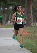 Nov 1, 2017; Long Beach, CA, USA; Leslie Diaz of Long Beach Poly wins the girls race in a course record 17:21 during the Moore League cross country finals at Heartwell Park.