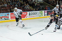 KELOWNA, CANADA - FEBRUARY 16: Riley Stadel #3 of Kelowna Rockets tries to block a shot by Adam Musil #25 of Red Deer Rebels on February 16, 2016 at Prospera Place in Kelowna, British Columbia, Canada.  (Photo by Marissa Baecker/Shoot the Breeze)  *** Local Caption ***Adam Musil; Riley Stadel;