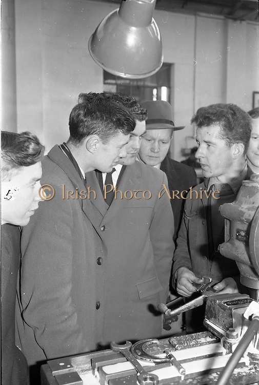 21/02/1963.02/21/1963.21 February 1963.Teachers tour Bord na Mona workshops. Vocational school teachers, whose past pupils include Bord na Mona apprntices, were guests at three of the Board's workshops., to study the organisation of the workshops and watch apprntices on the job. (l-r) Teachers Tom Wright (Ferbane V.S.) and Phil Ryan (Kildare V.S.) along with the county C.E.O., Mr. D. McSweeny in discussion with Senior Apprentice John Glennon at Derrygreenagh milled-peat works, Co. Offaly.