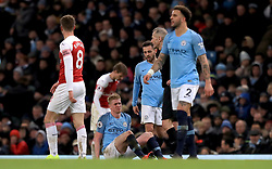 Manchester City's Kevin De Bruyne (second left) goes down injured before being replaced by Riyad Mahrez