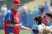 LOS ANGELES, CA - AUGUST 10:  Ryan Madson #46 of the Philadelphia Phillies signs autographs before the game against the Los Angeles Dodgers on August 10, 2011 at Dodger Stadium in Los Angeles, California. The Phillies won the game 9-8. (Photo by Paul Spinelli/MLB Photos via Getty Images) *** Local Caption *** Ryan Madson