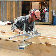 June 16, 2011. Cutting deck frames with a chain saw and jig.