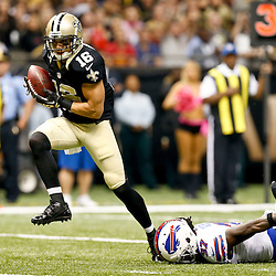 Oct 27, 2013; New Orleans, LA, USA; New Orleans Saints wide receiver Lance Moore (16) catches a touchdown past Buffalo Bills defensive back Nickell Robey (37) during the first quarter of a game at Mercedes-Benz Superdome. Mandatory Credit: Derick E. Hingle-USA TODAY Sports