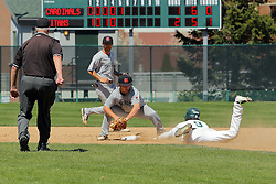 17 April 2016:  Adam Glogovsky slides long and safe into second base during an NCAA division 3 College Conference of Illinois and Wisconsin (CCIW) Pay in Baseball game during the Conference Championship series between the North Central Cardinals and the Illinois Wesleyan Titans at Jack Horenberger Stadium, Bloomington IL