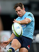 Waratahs Bernard Foley gets a kick away against the Highalnders in the Super 15 rugby match, Forsyth Barr Stadium, Dunedin, New Zealand, Saturday, March 14, 2015. Credit: SNPA/Dianne Manson