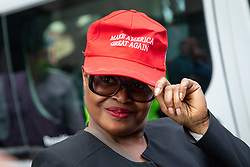 © Licensed to London News Pictures. 03/06/2019. London, UK. A Pro-Trump supporter shows her cap outside Westminster Abbey, as the President of the United States Donald Trump (not pictured) arrives at Westminster Abbey to lay a wreath at the Tomb of the Unknown Warrior. Photo credit : Tom Nicholson/LNP