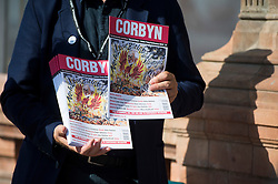 © Licensed to London News Pictures. 26/09/2015. Brighton, UK. A man handing out a Jeremy Corbyn branded labour party leaflet outside the conference venue on the eve of the Labour Party conference, which is being held in Brighton. Photo credit: Ben Cawthra/LNP