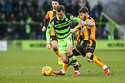 Forest Green Rovers Christian Doidge(9) is tackled by Cambridge United's Gary Deegan(4) during the EFL Sky Bet League 2 match between Forest Green Rovers and Cambridge United at the New Lawn, Forest Green, United Kingdom on 20 January 2018. Photo by Shane Healey.