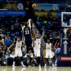 Dec 5, 2016; New Orleans, LA, USA; Memphis Grizzlies center Marc Gasol (33) shoots a three pointer over New Orleans Pelicans forward Terrence Jones (9) in the final seconds of the fourth quarter of a game at the Smoothie King Center. The Grizzlies defeated the Pelicans 110-108 in double overtime.  Mandatory Credit: Derick E. Hingle-USA TODAY Sports