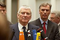 05 FEB 2004, BERLIN/GERMANY:<br /> Otto Schily (L-vorne), SPD, Bundesinnenminister, und Joerg Ziercke (R-hinten), desig. Praesident des Bundeskriminalamtes und derzeitiger Abteilungsleiter Polizei im Innenministerium Schleswig-Holstein, waehrend einem Pressestatement, nach der Pressekonferenz zur Vorstellung des neuen BKA-Praesidenten, Bundespressekonferenz<br /> IMAGE: 20040205-02-041<br /> KEYWORDS: Jörg Ziercke, Präsident, Bundeskriminalamt, Mikrofon, microphone,