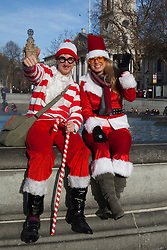 © Licensed to London News Pictures. 10/12/2011. London, UK. Around 1,000 Santas gathered in London's Trafalgar Square for the annual Santacon Christmas celebrations. Photo credit: Bettina Strenske/LNP