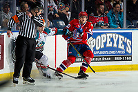KELOWNA, BC - MARCH 13: Egor Arbuzov #42 of the Spokane Chiefs checks Ted Brennan #10 of the Kelowna Rockets at Prospera Place on March 13, 2019 in Kelowna, Canada. (Photo by Marissa Baecker/Getty Images)