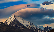 Wind cloud at sunset flies over summit ridge Aoraki / Mount Cook from Tasman Point, Aoraki / Mount Cook National Park, New Zealand