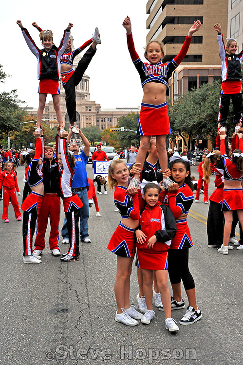 Capital Cheer & Gymnastics performing at the 20th Annual Chuy's Children Giving to Children Parade, Austin, Texas, November 29, 2008. Chuy's is a Tex Mex restaurant in Austin.  The Children Giving to Children Parade features gifts given by the viewers to Operation Blue Santa.