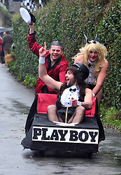 © Licensed to London News Pictures.01/01/2018<br /> SUTTON VALENCE, UK.<br /> PLAYBOY TEAMING WINNING.<br /> The traditional New Years day Sutton Valence Pram Race in Kent continued this year. In its 38th year the Race was struck by tragedy last year when competitor Francis 'Titch' O' Sullivan tipped over in his spitfire pram and hit his head on the curb, he passed away a day later. A coroners court reported he was not wearing a helmet.<br />  All babies in the pram's have to wear a helmet and the pushers must have contact with the pram and the ground at all times.<br />  <br /> Photo credit: Grant Falvey/LNP