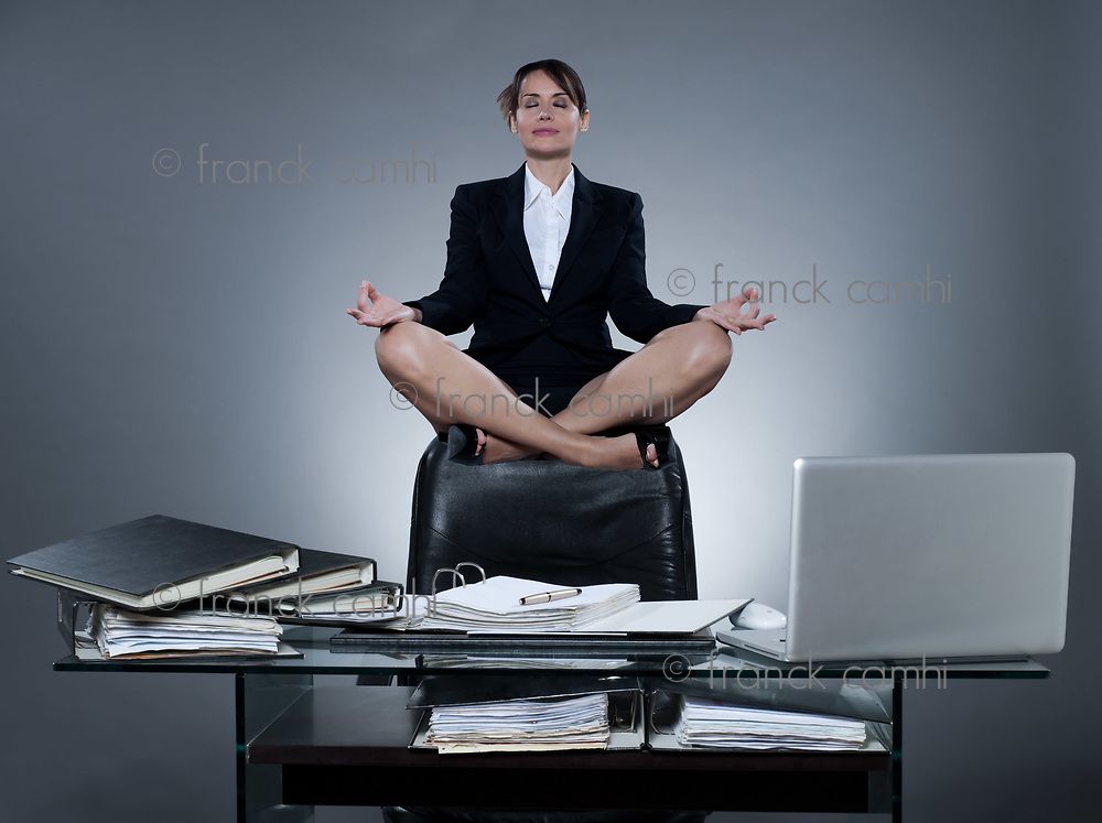 beautiful cheerful caucasian  business ecretary woman levitate from her desk on isolated background