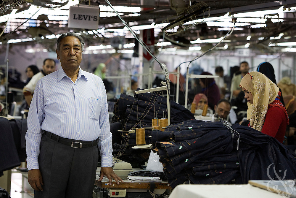 Air Marshal Man Mohan Sinha, chairman of Velocity Apparelz CO poses for a photograph October 27, 2008 on the production floor at the Velocity factory in Ismailia (130 kilometers north of Cairo, Egypt.)  Sinha and his son Siddharth, CEO of the parent company Vogue International Agencies FZE are Indian businessmen who have been operating their jeans company in Egypt since 2001, employing 2700 Egyptian workers while supplying jeans to major companies that include Levis, Target, and Zara.