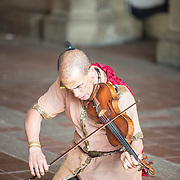 Busker in costume playing violin in Central Park.