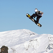 Nicholas Wood, Australia, in action during the Men's Snowboard Slopestyle competition at Snow Park, New Zealand during the Winter Games. Wanaka, New Zealand, 21th August 2011. Photo Tim Clayton
