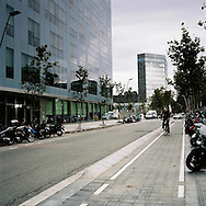 Barcelona, Spain. A cyclist crosses a street of @22 technological district of Barcelona.