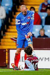 Scott Cuthbert of Leyton Orient helps to stretch the leg of his opponent Jack Grealish of Aston Villa - Photo mandatory by-line: Rogan Thomson/JMP - 07966 386802 - 27/08/2014 - SPORT - FOOTBALL - Villa Park, Birmingham - Aston Villa v Leyton Orient - Capital One Cup Round 2.