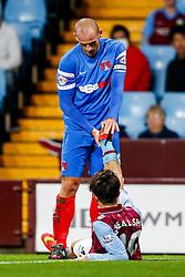 Scott Cuthbert of Leyton Orient helps to stretch the leg of his opponent Jack Grealish of Aston Villa - Photo mandatory by-line: Rogan Thomson/JMP - 07966 386802 - 27/08/2014 - SPORT - FOOTBALL - Villa Park, Birmingham - Aston Villa v Leyton Orient - Capital One Cup Round 2.