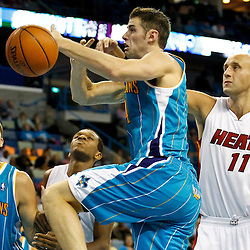 October 13, 2010; New Orleans, LA, USA; Miami Heat center Zydrunas Ilgauskas (11) knocks the ball away from New Orleans Hornets power forward Jason Smith (14) during the second half of a preseason game at the New Orleans Arena. The Hornets defeated the Heat 90-76. Mandatory Credit: Derick E. Hingle