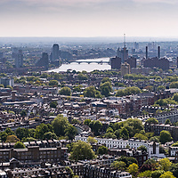 An aerial view of London in England UK with the river Thames in the distance