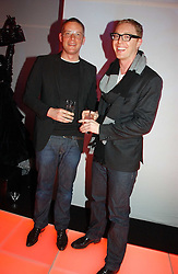 Left to right, designer GILES DEACON and STUART VEVERS Design Director of Mulberry at a party to celebrate the launch of a range of leather accessories designed by Giles Deacon for Mulberry held at Harvey Nichols, Knightsbridge, London on 30th October 2007.<br />