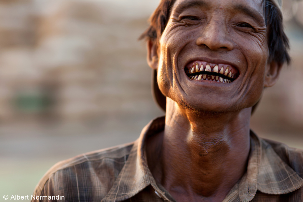 Peanut farmer with Betel Nut stained teeth,jetty, Mandalay