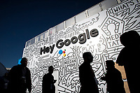 Attendees walk past the Google Inc. booth during the 2018 Consumer Electronics Show (CES) in Las Vegas, Nevada, U.S., on Thursday, Jan. 11, 2018. Electric and driverless cars will remain a big part of this year's CES, as makers of high-tech cameras, batteries, and AI software vie to climb into automakers' dashboards. Photographer: David Paul Morris