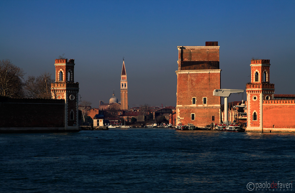 The eastern gate of the Arsenal of Venice, accessible only from the sea. Taken from the water bus on a beautiful morning of mid January. In the background, the bell tower of the church of San Francesco della Vigna.