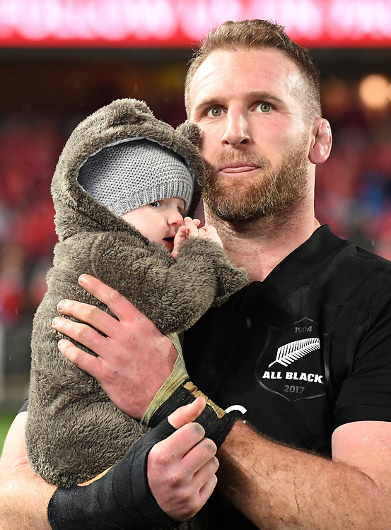 """Keiran Read of New Zealand with his son Rueben before receiving his 100th test cap played against the Lions in the third International rugby test match between the the New Zealand All Blacks and British and Irish Lions at Eden Park, Auckland, New Zealand, Saturday, July 08, 2017. Credit:SNPA / Ross Setford  **NO ARCHIVING"""""""
